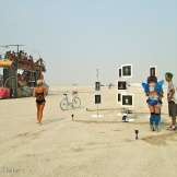 So now the big opening. Dozens of folks perched on an art car, cruising the Playa on an art tour...